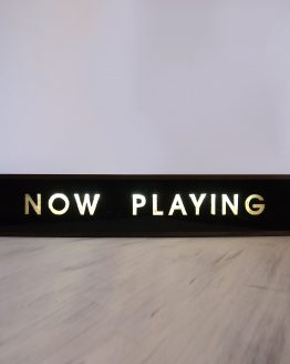 hand painted now playing sign with wooden lightbox