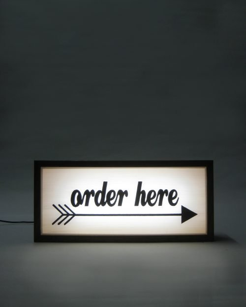 Order Here Sign With Direction