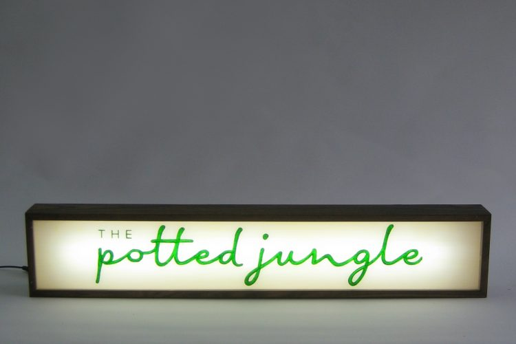 custom business sign the potted jungle lightbox
